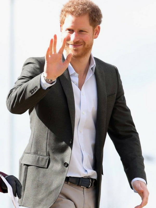 Prince Harry is often found in blue suits, but this warmer-toned look is very flattering on him.