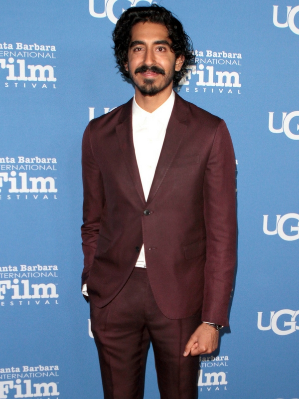 This colour is incredibly flattering on Dev Patel. What a great suit!