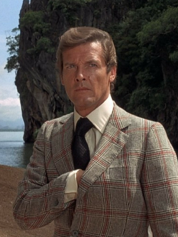 Roger Moore really suits the warm tones in this jacket. The pop of muted red in the check is very flattering.