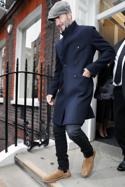The ever stylish, David Beckham, in a classic navy double-breasted overcoat.