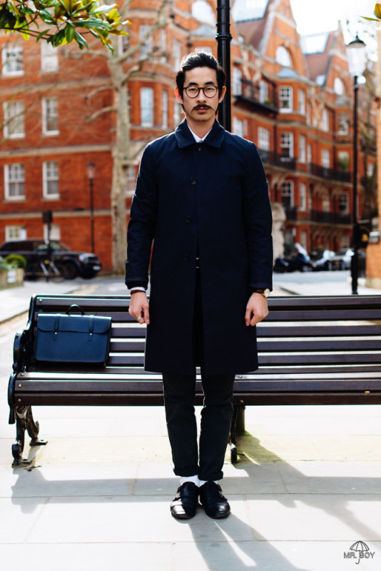 Karlmond Tang in a classic navy mackintosh.