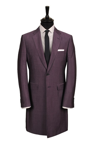 A beautiful nod to 60's mod-style fashion in our purple mohair knee-length jacket