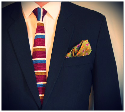 A complimenting tie and pocket square with a black suit