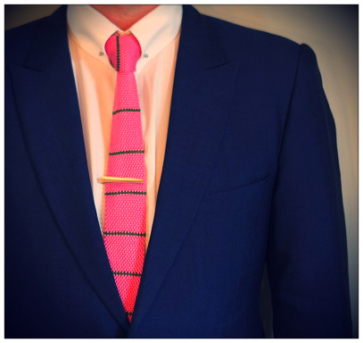 A Collar bar and matching Tie Pin with a navy blue suit