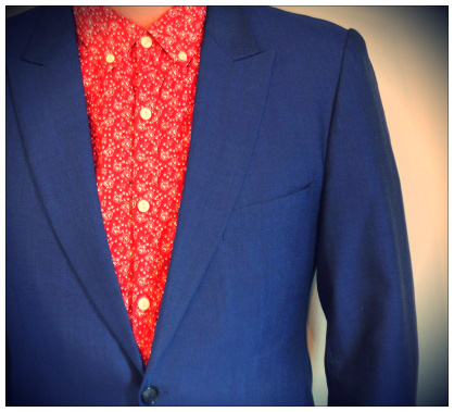 A blue mohair suit with a patterned shirt and no tie.