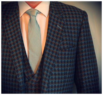 A bold patterned suit with a simple, tonal tie