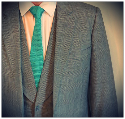 A Prince of Wales check suit with matching tie