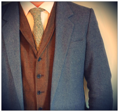 Tweed jacket, waistcoat and tie in complimentary colours