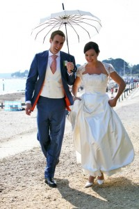 The Groom's waistcoat matches the Bride's dress perfectly