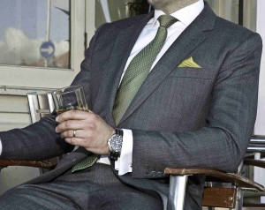An ideal dark grey interview suit, complete with a glass of whisky to steady the nerves!